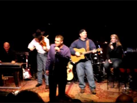 Chuck Lofgren singing with Garth Brooks and his band at the County Music Hall of Fame's Ford Theater in 2010.
