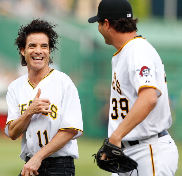 Train lead singer Patrick Monahan shares a laugh with Pirates' closer Jason Grill.