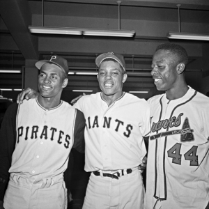 1961 National League All-Stars Roberto Clemente, Willie Mays and Hank Aaron pose for a post-game photo.