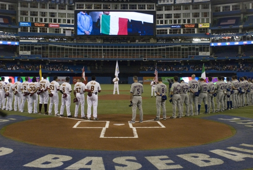 Grilli and Team Italia stand at attention during the playing of the Italian National Anthem before facing Venezuela in the 2009 WBC.