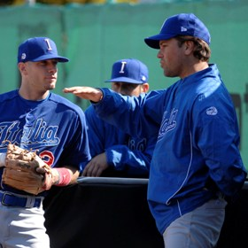 Team Italy hitting coach Mike Piazza gives some sound advice to infielder Anthony Granato in the 2010 European Baseball Championship Finals.