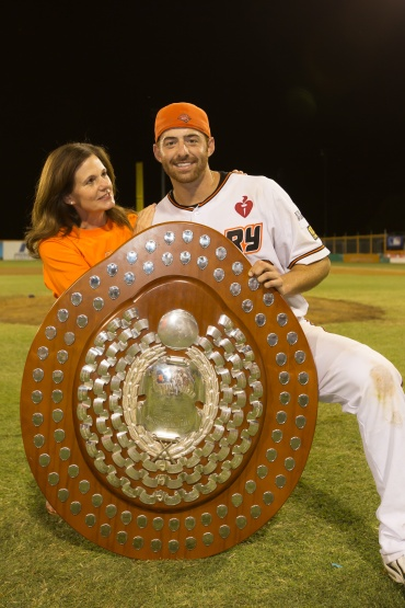 #1 American in the ABL and Triple Crown Winner Adam Buschini and his mother hold the Claxton Shield after winning the 2013 ABL Championship Series Narrabundah Ballpark, Canberra, ACT, Australia on February 9, 2012. (Ben Southall/SMP Images/ABL)