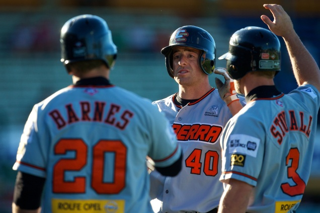 #1 Adam Buschini of the Canberra Cavalry is congratulated by American teammates Jeremy Barnes and Ryan Stovall. (Ryan Schembri/SMP Images/ABL)