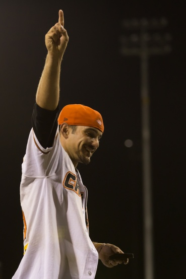 Kody Hightower celebrates the Canberra Cavalry receiving the Claxton Shield after winning the 2013 ABL Championship Series. (Ben Southall/SMP Images)