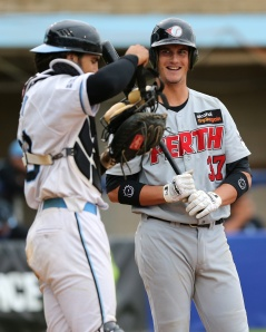 #7 Kody Hightower shares a laugh with catcher Geoff Klein. (Photo by Joe Vella / SMP Images)