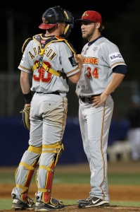Catcher Chris Adamson and Zac Fuesser discuss strategy. ( Joe Vella / SMP Images)