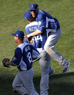 Anthony Rizzo lifts Alex Liddi after Team Italy upset Mexico in the 2013 World Baseball Classic on March 7th at Salt River Fields in Scottsdale, Arizona.