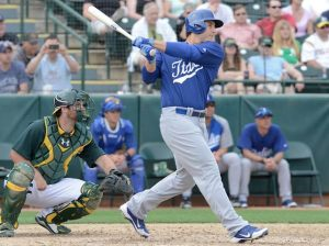Anthony Rizzo makes contact in an exhibition game against the Oakland A's at Phoenix Municipal Stadium on March 5th.