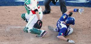 Chris Denorfia slides into home safely to score the winning run against Team Mexico in the 2013 WBC.