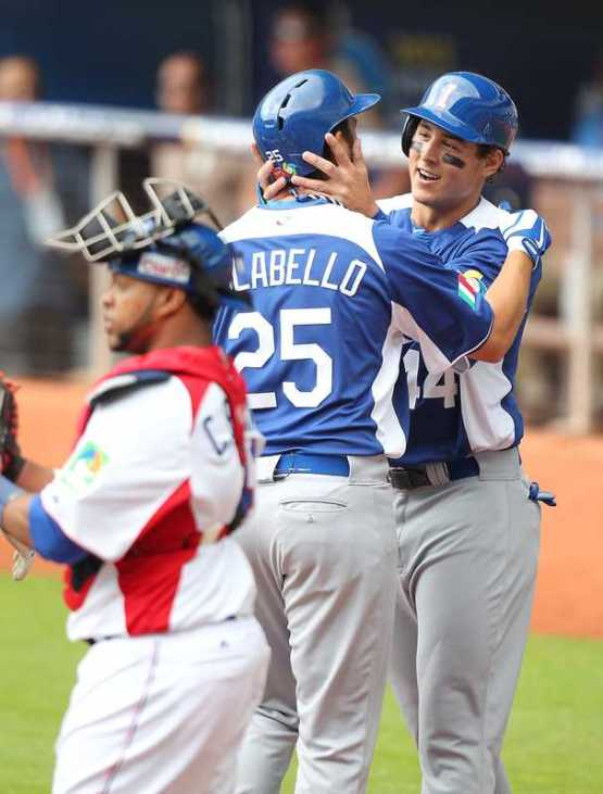 Anthony Rizzo congratulates Team Italy DH Chris Colabello after hitting a three-run home run in the first inning against 2013 WBC Champion Dominican Republic at Marlins Park.