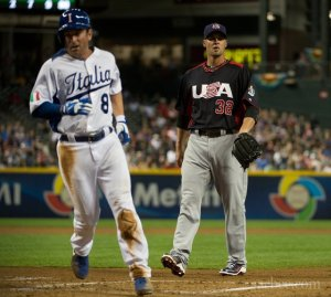 Team Italy's Nick Punto scores on a wild pitch by Team USA's Ryan Vogelsong in the bottom of the first inning in the 2013 World Baseball Classic at Chase Field in Phoenix, Arizona on March 9th.