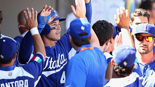 Anthony Rizzo is congratulated after his two-run double which led to Italy's 6-5 win over Mexico.