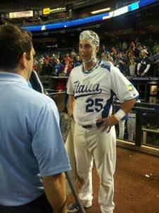 Chris Colabello gets creamed after being named Chevrolet Player of the Game against Canada.