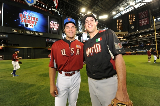 Italian National team coach Mike Piazza (shown here as coach of Team U.S.A.) and Seattle Mariners Alex Liddi (shown here playing for Team World) in the 2011 All-Star Futures Game