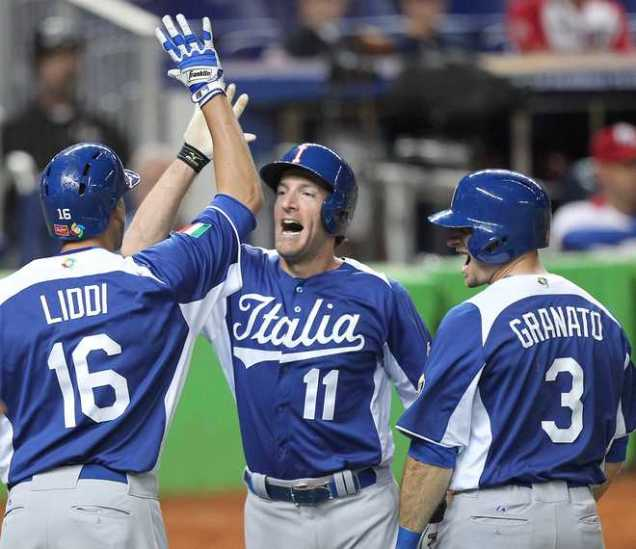 Padres' Chris Denorfia is congratulated by Orioles' Alex Liddi in the 2013 World Baseball Classic.