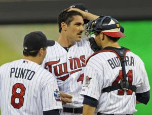 Nick Punto, Carl Pavano and Drew Butera in 2010.