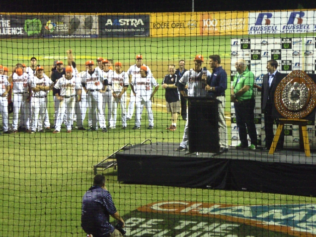 Canberra Cavalry head coach Michael Collins accepts the prized Claxton Shield after winning the 2012-13 ABL Championship.
