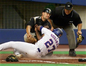 Vladimir Guerrero collides with catcher  Jason Kendall.