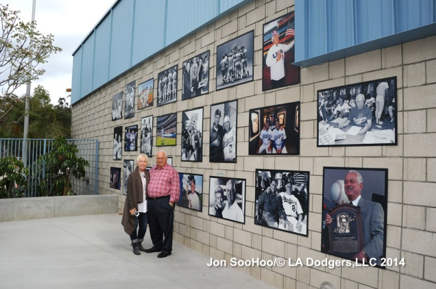 Standing with his daughter, Laura, Tommy poses near the  Lasorda Tribute display at Dodger Stadium.
