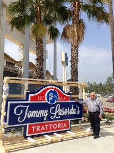 Tommy stands proudly next to his sign.