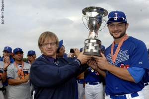 Team Italia captain Mario Chairini accepts the 2012 European Cup after the Italians beat the Netherlands.