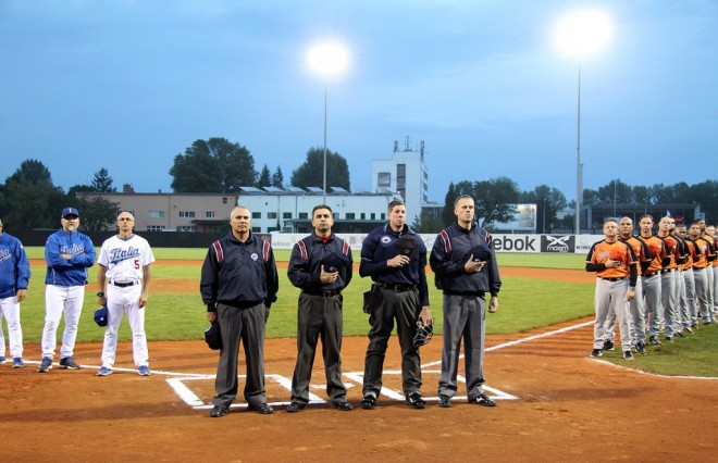 Team Italia manager Marco Mazzieri (second from left) with bench coach Marco Nanni (far left) prior to the Netherlands game on September 20, 2014 at Draci Ballpark in Brno, Czech Republic (Photo courtesy of Mister-Baseball.com).