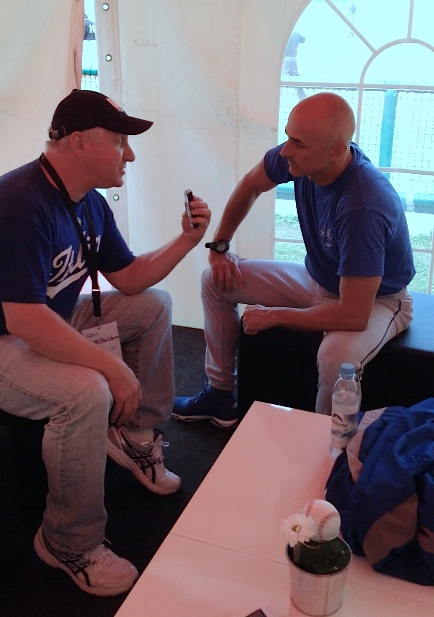 Roberto Angotti interviews Team Italia manager Marco Mazzieri at the 2014 Euro Baseball Championship (Photo courtesy of IandI-GoPro.com).