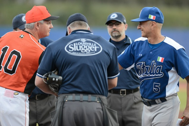 Kingdom of the Netherlands manager Steve Janssen and Italia manager Marco Mazzieri exchange lineup cards prior to the start of their game in the 2016 European Baseball Championship. (photo courtesy of Enzio /FIBS)