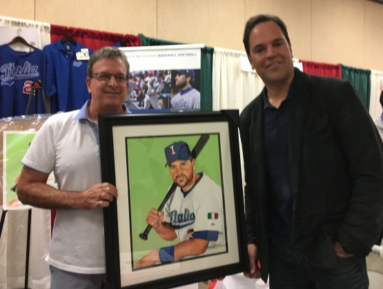 Italian American Baseball Family's Joe Quagliano and Mike Piazza hold James Fiorentino's portrait of the Hall of Famer.